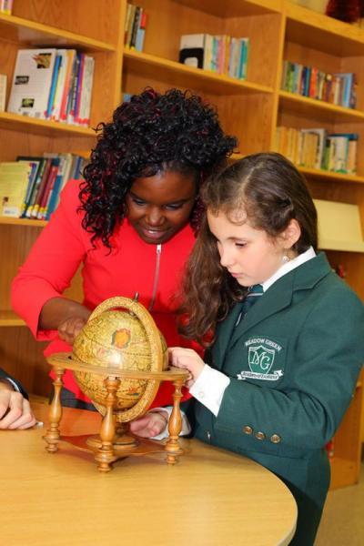teacher-globe-student-library-2013-694
